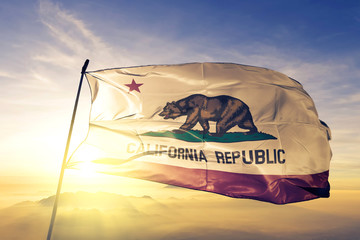 California state of United States flag waving on the top sunrise mist fog Wall mural