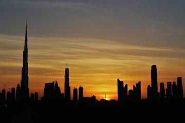 silhouette of Burj Khalifa during golden hou