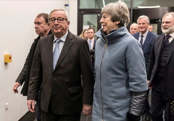 European Commission President Jean-Claude Juncker welcomes Britain's Prime Minister Theresa May at the European Parliament in Strasbourg