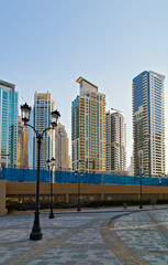 Modern buildings in Dubai, skyscrapers architecture desert locations UAE.
