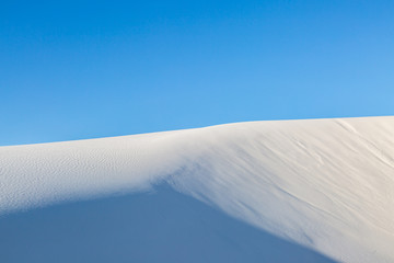 White gypsum sand in White Sands National Monument, with a clear blue sky overhead