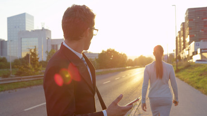 SUN FLARE: Yuppie stops and stares at the gorgeous businesswoman walking to work