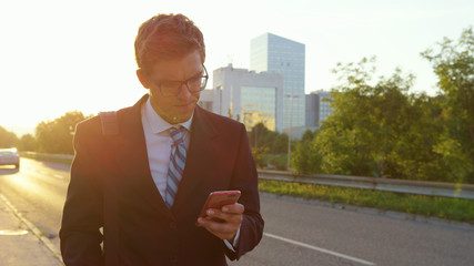 CLOSE UP: Businessman reading a text and getting bad news while walking home