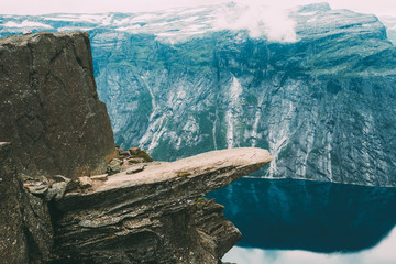 Scenic View Of Rock Trolltunga - Troll Tongue In Norway. Rock In The Mountains Of Norway
