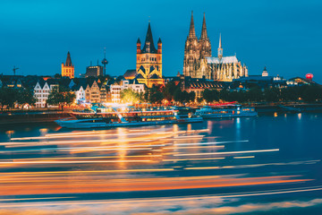 Great St. Martin Church And Dom In Cologne At Evening With Reflection In River Rhine, Germany