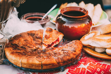 Dishes of the traditional Belarusian cuisine - pie and honey.