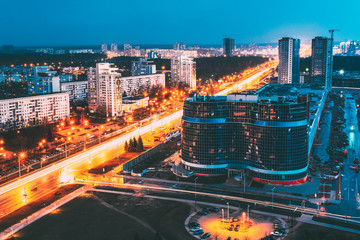 Minsk, Belarus. Aerial Cityscape In Bright Blue Hour Evening And Yellow Illumination Spring Twilight.