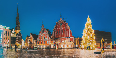 Riga, Latvia. Panorama Of Town Hall Square, Popular Place With Famous Landmarks On It In Night Illumination In Winter Twilight. Winter New Year Christmas Holiday Season