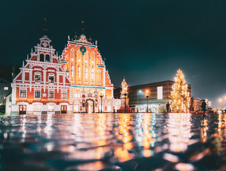 Riga, Latvia. Town Hall Square, Popular Place With Famous Landmarks On It In Night Illumination In Winter Twilight. Winter New Year Christmas Holiday Season