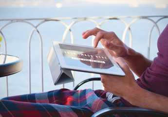 Person using Tablet Outdoors Mockup