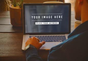 User on Laptop at Home Mockup