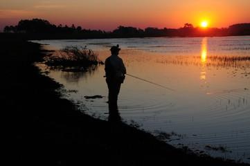 Silhueta de pescador