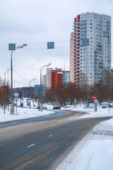 Moscow, Russia - March, 4, 2019: image of an empty highway in the background of residential buildings in winter in Moscow