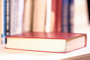 image of a book lying on the shelf
