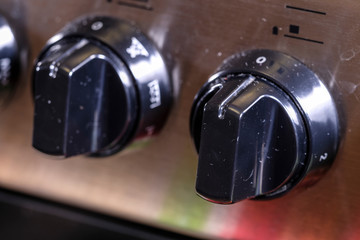 image of stove handles close up