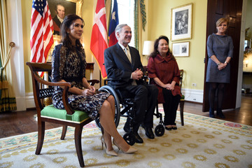 Danish Crown Princess Mary poses for photos inside the Governors Mansion with Texas Governor Greg Abbott and the First Lady of Texas Cecilia Abbott in Austin