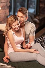 Loving husband kissing his lovely tender wife in the bedroom