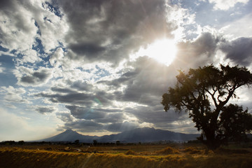 photo of the popocatepetl and iztaccihuatl volcanos, with a dramatic sky