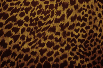 Leopard, jaguar. Fur pattern on the fabric. Print color and black and white.