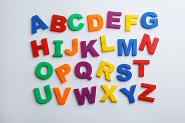 Plastic magnetic letters isolated on white, top view. Alphabetical order Wall mural