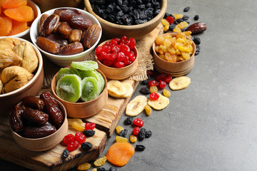 Bowls with different dried fruits on table, space for text. Healthy food