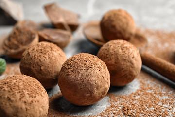 Fototapeta Delicious raw chocolate truffles on grey background obraz