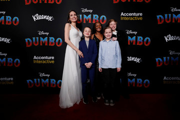 """Angelina Jolie pose with her children at the premiere for the movie """"Dumbo"""" in Los Angeles"""