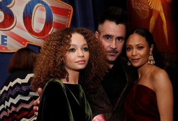 "Cast members Colin Farrell, Nico Parker pose with Thandie Newton at the premiere for the movie ""Dumbo"" in Los Angeles"