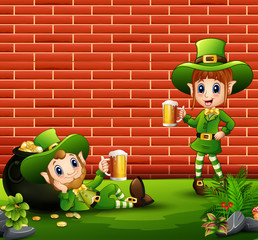 Happy leprechauns boy and girl holding a beer