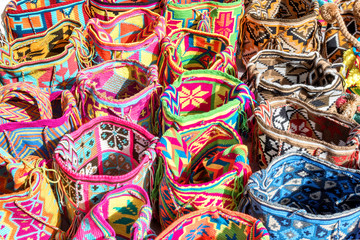 Mochilas guayu, colorful knit bags for sale in Bogota, Colombia at a street market