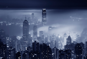 Fog over Hong Kong city at night