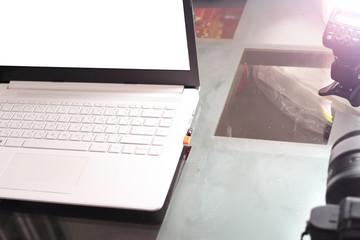Computer notebook on table and camera