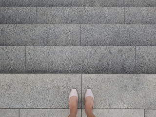 A business woman on the stairs