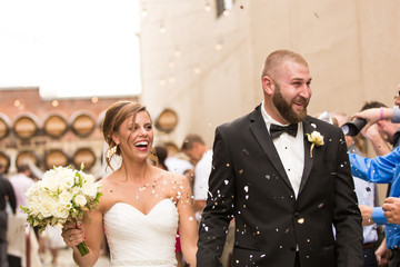 Smiling Bride and Groom with confetti