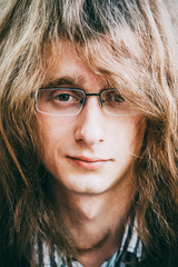Portrait Of Rock Star Young Man Guy With Glasses And Long Hair