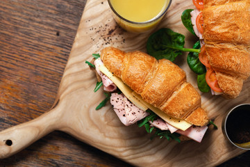 Croissants catering Croissant sandwiches orange juice served wooden board
