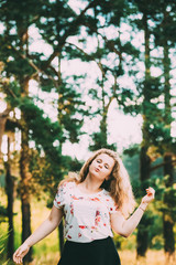 Young Pretty Plus Size Caucasian Happy Smiling Laughing Girl Woman Dancing In Summer Green Forest. Fun Enjoy Outdoor Summer Nature.