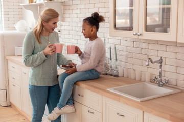 Mother and daughter enjoying weekend spending morning together