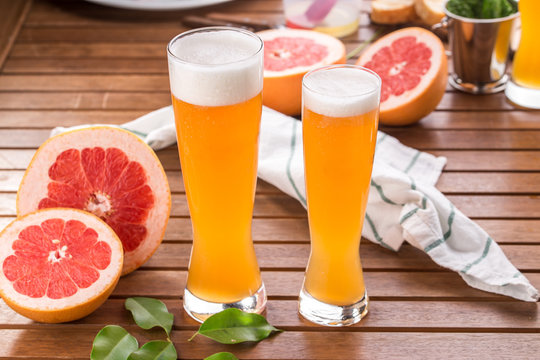 glass of sour Grapefruit Craft Beer on wooden table