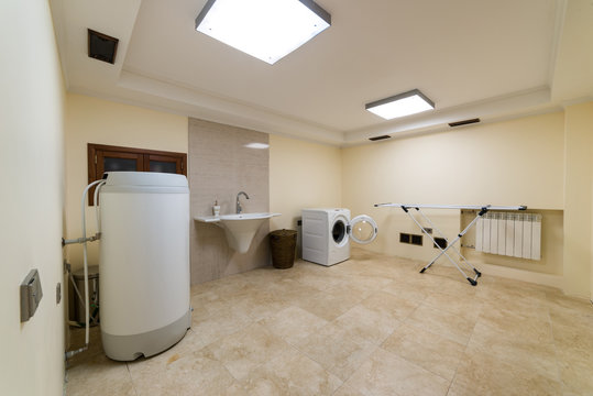 Laundry room with boiler