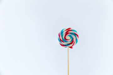 colorful handmade swirl lollipop isolated on white background. multicolored lollipop, Tasty colorful fruit flavored candy. striped lollipop.sweet candy making from sugar on white background.