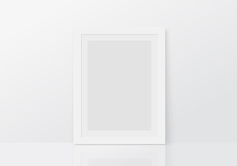 Mock up with vertical empty white frame standing on floor. Blank photo frame template.