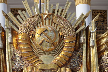USSR coat of arms, communist and socialist symbol. Restored soviet emblem on facade of Central pavilion on VDNH in Moscow