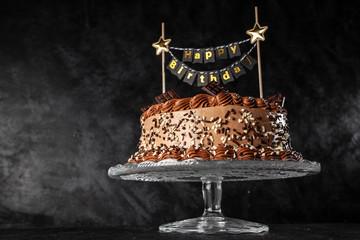 Fotoväggar - Decorated chocolate cake on dark background