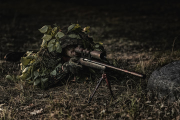 Camouflaged sniper
