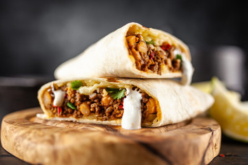 Fotoväggar - Mexican burrito with beef, beans and sour cream