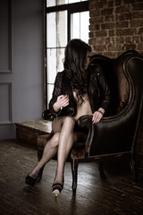 Sexy woman dark boudoir. Sensual girl in half naked look , lady in erotic pose