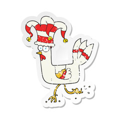 retro distressed sticker of a cartoon chicken running in funny hat