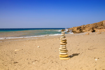 Stone stacking in a bay of Akamas Peninsula National Park, Cyprus