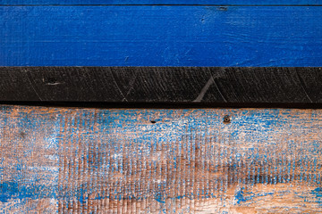 Türaufkleber Grill / Barbecue Derevyanny old textural painted colorful background. Blue and shabby blue, separated by a black board.